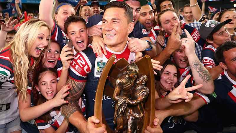 Seen here, Sonny Bill Williams holds the trophy after the Roosters' 2013 grand final win.