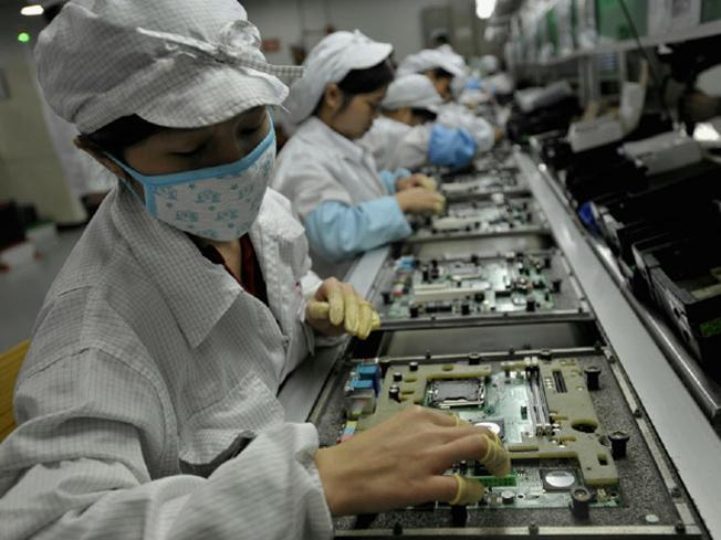 Foxconn assembly line workers
