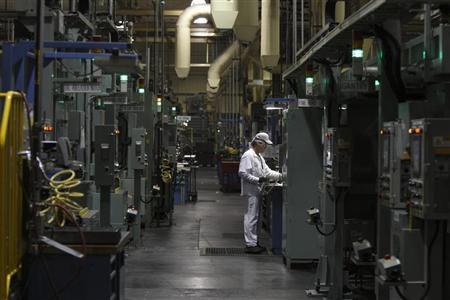 An associate is seen working in the connecting rod area during a tour of the Honda automotive engine plant in Anna, Ohio October 11, 2012. REUTERS/Paul Vernon