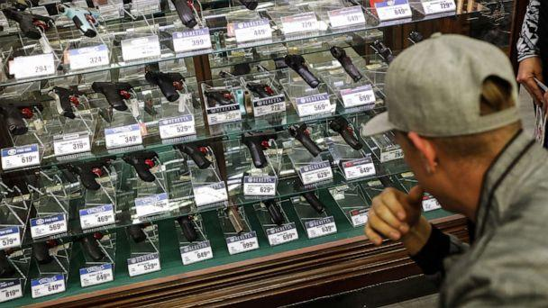 PHOTO: A shopper browses handheld firearms for sale inside a Bass Pro Outdoor World LLC store on Black Friday in Tampa, Fla., Nov. 23, 2018. (Eve Edelheit/Bloomberg via Getty Images, FILE)