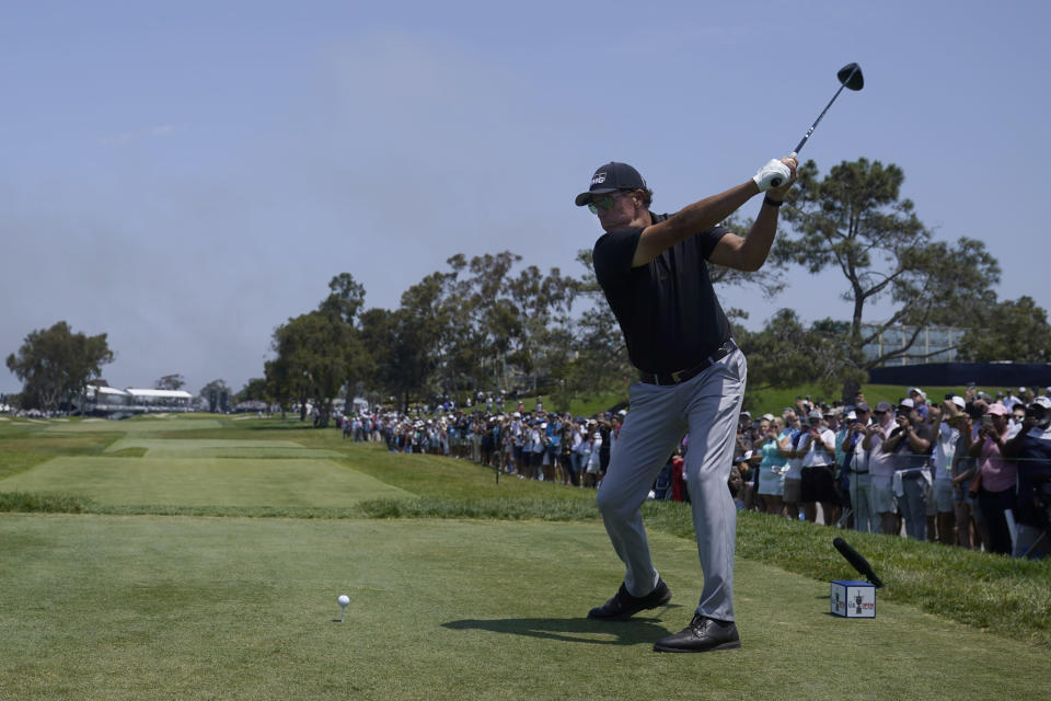 Phil Mickelson plays his shot from the 18th tee during the first round of the U.S. Open Golf Championship, Thursday, June 17, 2021, at Torrey Pines Golf Course in San Diego. (AP Photo/Marcio Jose Sanchez)