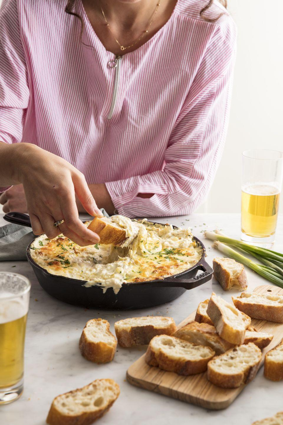 """<p>This dip will make you forget all about plain spinach and artichoke.</p><p>Get the recipe from <a href=""""https://www.delish.com/cooking/recipe-ideas/recipes/a49883/crab-artichoke-dip-recipe/"""" rel=""""nofollow noopener"""" target=""""_blank"""" data-ylk=""""slk:Delish"""" class=""""link rapid-noclick-resp"""">Delish</a>. </p>"""