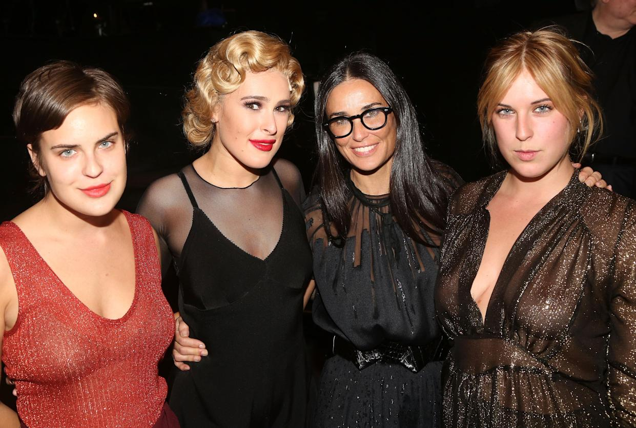 Demi Moore stars in new swimsuit campaign alongside her three daughters. (Getty Images)