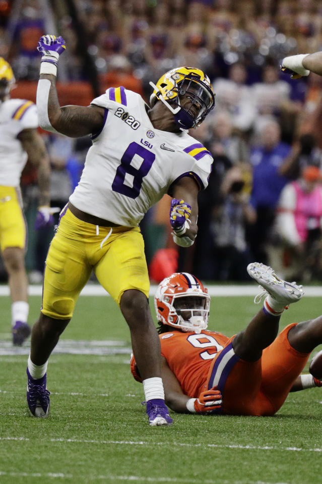 LSU linebacker Patrick Queen celebrates after tackling Clemson running back Travis Etienne during the second half of a NCAA College Football Playoff national championship game Monday, Jan. 13, 2020, in New Orleans. (AP Photo/Sue Ogrocki)