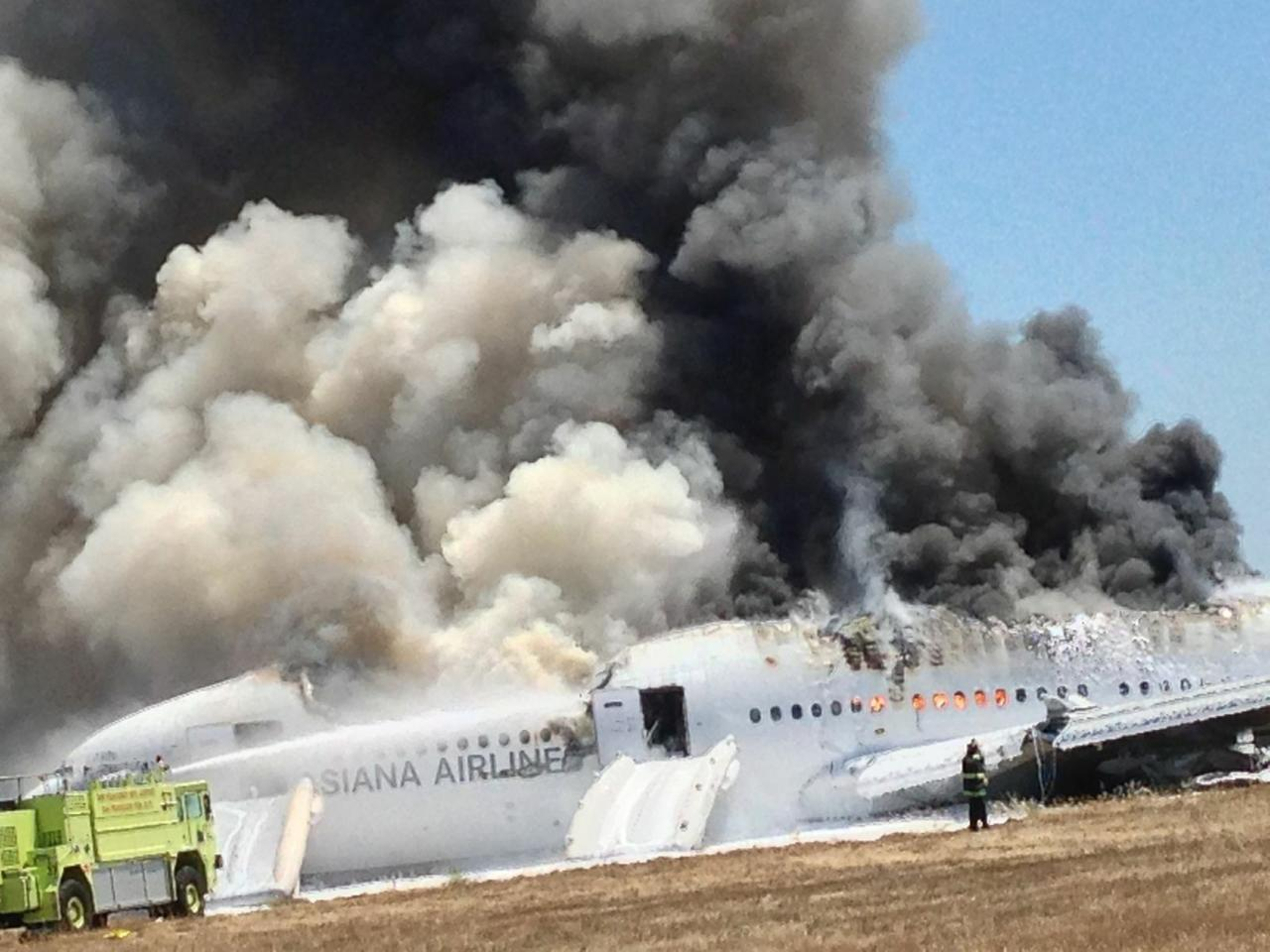 An Asiana Airlines Boeing 777 plane is engulfed in smoke on the tarmac after a crash landing at San Francisco International Airport in California July 6, 2013, in this handout file photo provided by passenger Eugene Anthony Rah, released to Reuters on July 8, 2013. U.S. safety investigators are looking closely at whether an over-reliance on autopilot systems in modern aircraft has degraded human flying skills, increasing the risk of accidents. At a two-day hearing that starts on December 10, 2013, the NTSB will examine if cockpit complacency caused the Asiana Airlines Inc's jetliner with 307 people aboard to crash land at San Francisco International Airport in July, killing three and injuring more than 180.REUTERS/Eugene Anthony Rah/Handout via Reuters/Files (UNITED STATES - Tags: TRANSPORT DISASTER) ATTENTION EDITORS - FOR EDITORIAL USE ONLY. NOT FOR SALE FOR MARKETING OR ADVERTISING CAMPAIGNS. THIS IMAGE HAS BEEN SUPPLIED BY A THIRD PARTY. IT IS DISTRIBUTED, EXACTLY AS RECEIVED BY REUTERS, AS A SERVICE TO CLIENTS. MANDATORY CREDIT