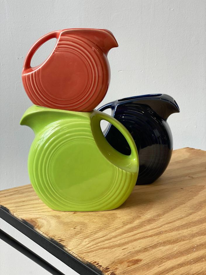 """These beloved, made-in-the-USA pitchers are a fixture on the vintage scene, and we're partial to the persimmon and lemongrass shades. $38, Portmanteau. <a href=""""https://www.portmanteaunewyork.com/new-arrivals/vintage-mini-persimmon-fiesta-ceramic-disc-pitcher-circa-1970s?rq=pitcher"""" rel=""""nofollow noopener"""" target=""""_blank"""" data-ylk=""""slk:Get it now!"""" class=""""link rapid-noclick-resp"""">Get it now!</a>"""