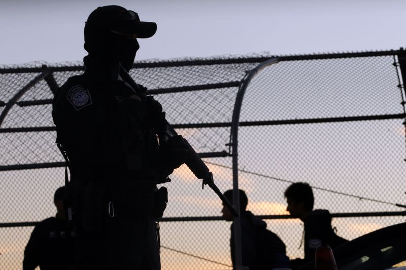 FILE PHOTO: A U.S Custom and Border Protection agent guards one of the gates at the border on the international bridge between Mexico and the U.S. in Ciudad Juarez