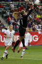 U.S. goalkeeper Alyssa Naeher blocks a shot during the first half of a CONCACAF women's Olympic qualifying soccer match against Canada Sunday, Feb. 9, 2020, in Carson, Calif. (AP Photo/Chris Carlson)