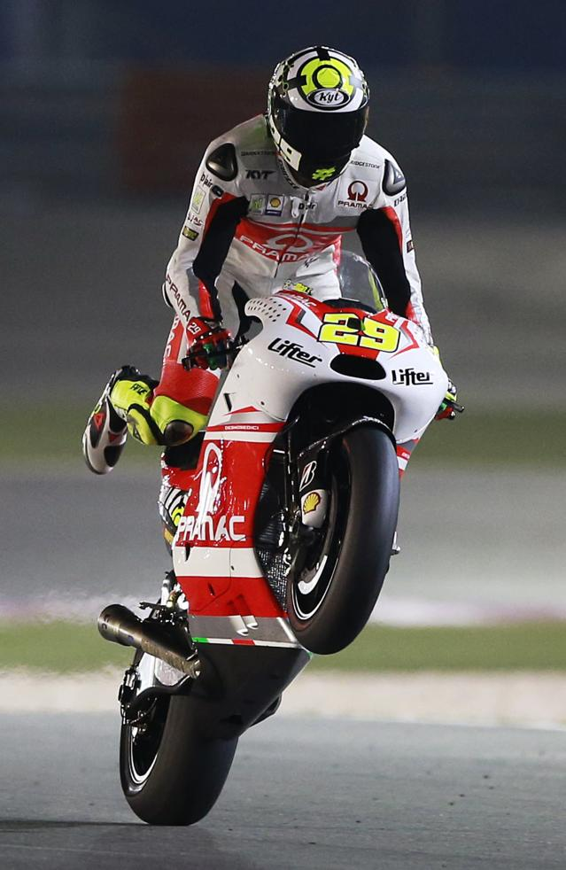 Pramac Racing rider Andrea Iannone of Italy rides his bike during a free practice session at the MotoGP World Championship at the Losail International circuit in Doha March 22, 2014. REUTERS/Mohammed Dabbous (QATAR - Tags: SPORT MOTORSPORT)