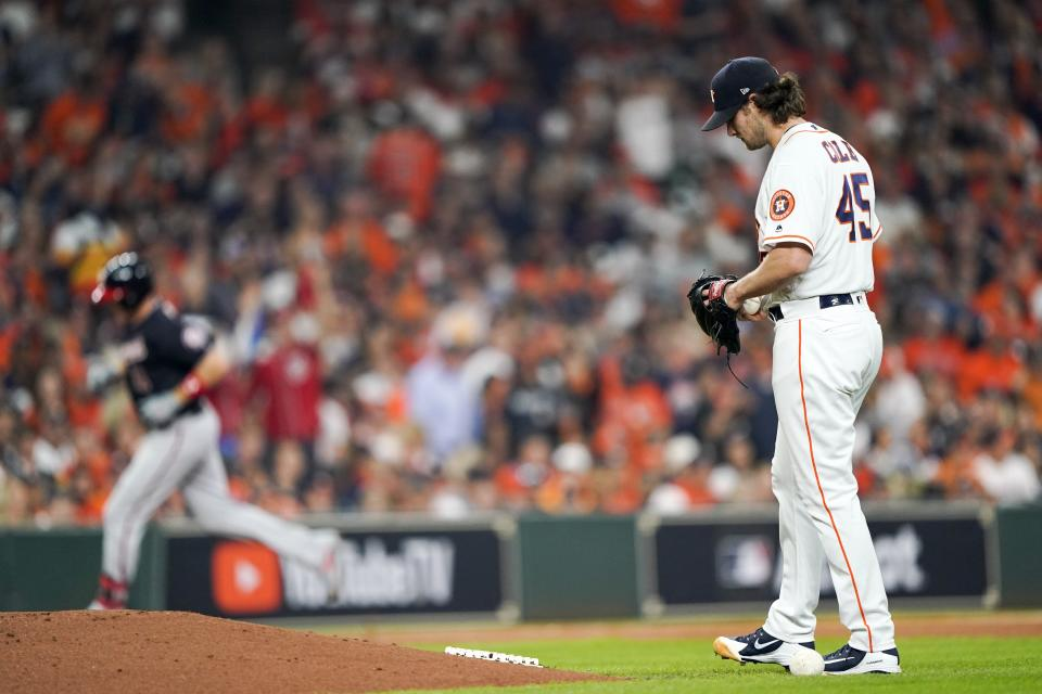 Houston Astros starting pitcher Gerrit Cole reacts after giving up a home run to Washington Nationals' Ryan Zimmerman during the second inning of Game 1 of the baseball World Series Tuesday, Oct. 22, 2019, in Houston. (AP Photo/David J. Phillip)