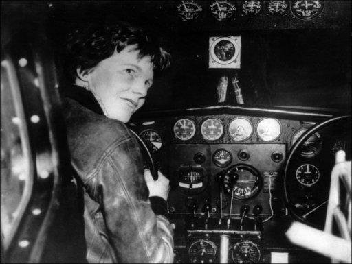American female aviator Amelia Earhart at the controls of her plane in the 1930s