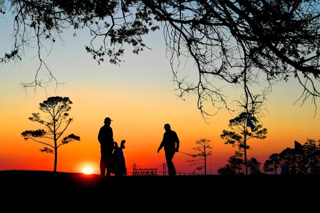 <p>(L-R) Ernie Els of South Africa with his caddie Cayce Kerr finish hitting chip shots on the practice area at sunset after the first round of The RSM Classic at the Sea Island Resort Seaside Course on November 16, 2017 in Sea Island, Georgia. (Photo by Stan Badz/PGA TOUR) </p>