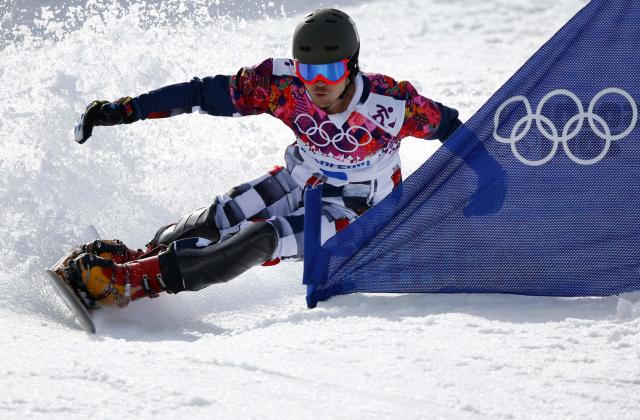 Russia's Vic Wild competes during his gold medal run during the men's snowboard parallel slalom final at the 2014 Sochi Winter Olympic Games in Rosa Khutor February 22, 2014. REUTERS/Mike Blake (RUSSIA - Tags: SPORT OLYMPICS SNOWBOARDING)