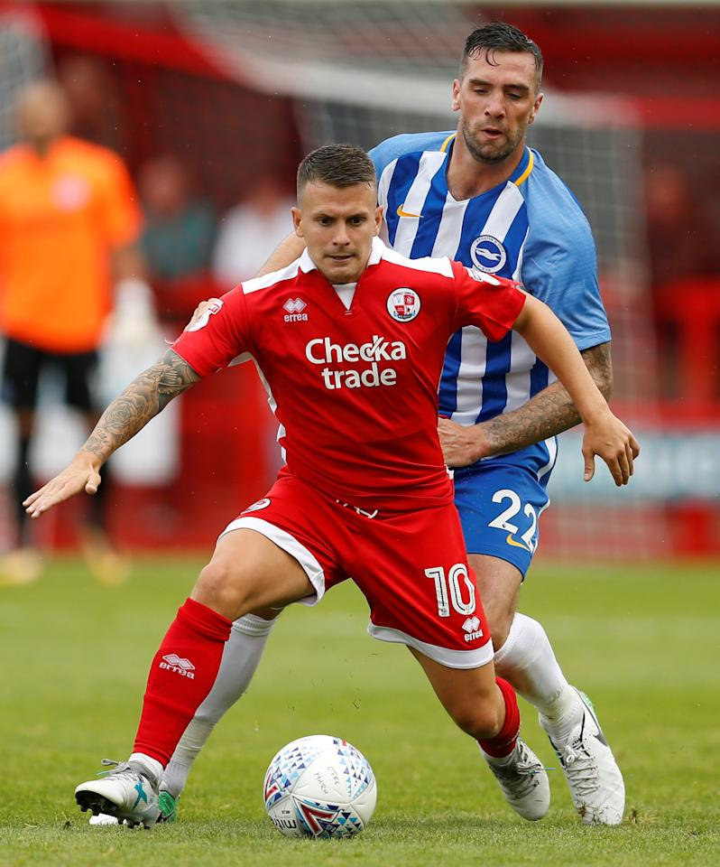 Soccer Football - Crawley Town vs Brighton & Hove Albion - Pre Season Friendly - June 22, 2017   Crawley Town's Dean Cox in action with Brighton & Hove Albion's Shane Duffy   Action Images via Reuters/Matthew Childs