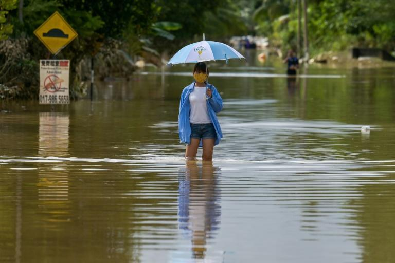 Monsoon rains on the east coast of Malaysia have caused flooding and forced almost 50,000 people to evacuate