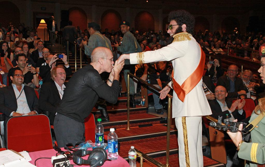 Jeffrey Katzenberg, producer and CEO of DreamWorks Animation, greets actor Sacha Baron Cohen at Caesars Palace during CinemaCon, the official convention of the National Association of Theatre Owners, April 23, 2012 in Las Vegas, Nevada.