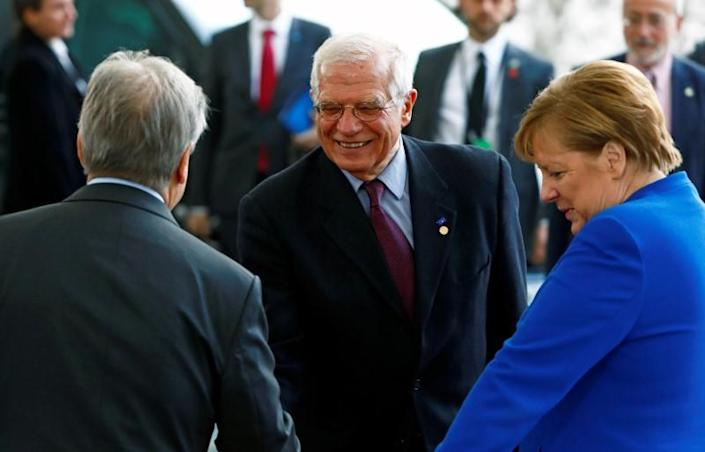 German Chancellor Angela Merkel and United Nations Secretary-General Antonio Guterres welcome European Union's Foreign Policy Chief Josep Borrell at the Libya summit in Berlin