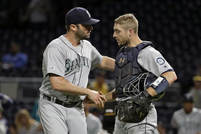 Seattle Mariners relief pitcher Matt Magill, left, and catcher Tom Murphy celebrate getting the final out of the team's 4-1 win over the Pittsburgh Pirates in a baseball game in Pittsburgh, Wednesday, Sept. 18, 2019. (AP Photo/Gene J. Puskar)