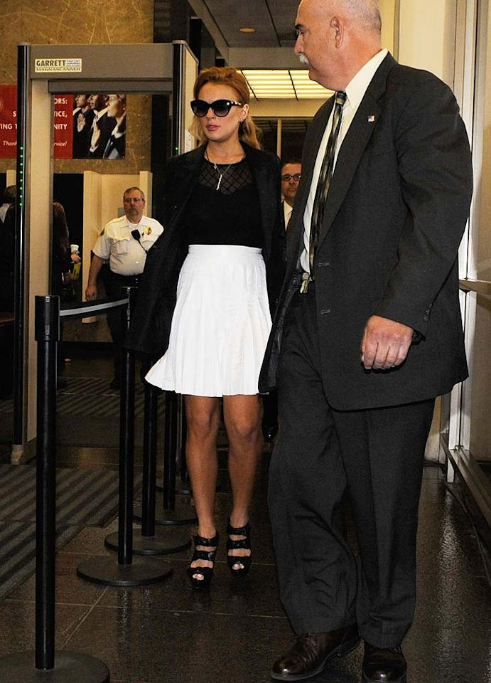 """After failing a random drug test last week, Lindsay Lohan found herself back in court on Friday, where she donned clothing from her own 6126 collection. The 24-year-old had to trade in her threads for an orange jumpsuit when Judge Elden Fox ordered her to return to jail until her probation violation hearing on October 22. Later that same day, Judge Patricia Schnegg reversed the decision and granted an appeal to release Lohan from jail on $300,000 bail. Pool/<a href=""""http://www.gettyimages.com/"""" target=""""new"""">GettyImages.com</a> - September 24, 2010"""