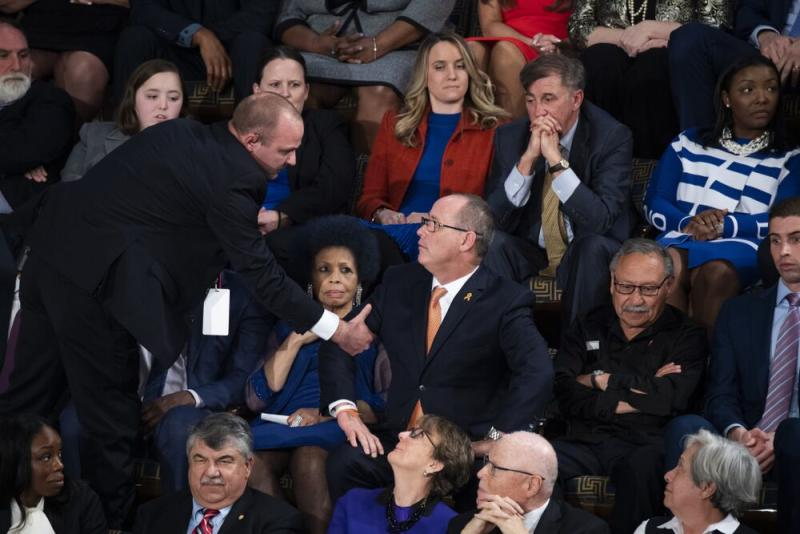 Fred Guttenberg getting escorted out of the State of the Union by Capitol Police on Tuesday. | Tom Williams/CQ-Roll Call, Inc via Getty