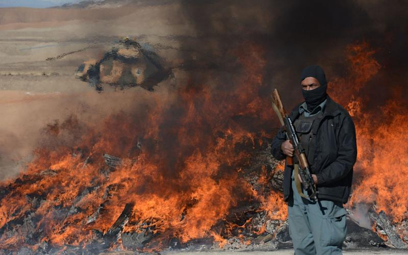 Drugs being burned after seized in Afghanistan - AFP