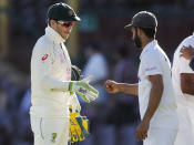 Rival captain's Australia's Tim Paine, left, and India's Ajinkya Rahane gesture to each other following play on the final day of the third cricket test between India and Australia at the Sydney Cricket Ground, Sydney, Australia, Monday, Jan. 11, 2021. The test ended in a draw and the series is at 1-1 all with one test to play. (AP Photo/Rick Rycroft)