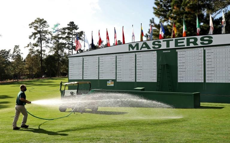 Masters crowds often gather at the scoreboard by the main entrance to the course, but they will be missing this week since spectators are barred from Augusta National due to the Covid-19 pandemic
