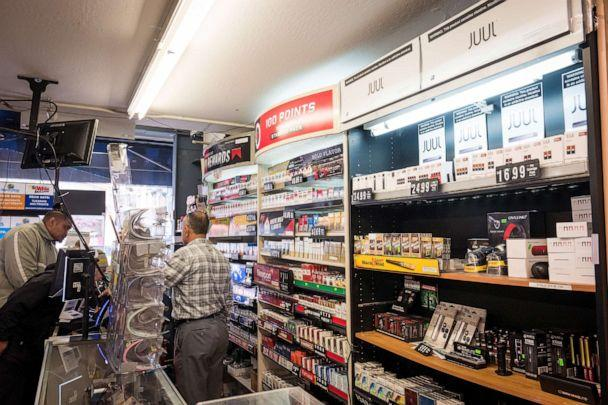 PHOTO: Packages of Juul Labs Inc. device kits and pods are displayed for sale next to tobacco products at a store in San Francisco, California, U.S., on Wednesday, June 26, 2019. (David Paul Morris/Bloomberg via Getty Images)
