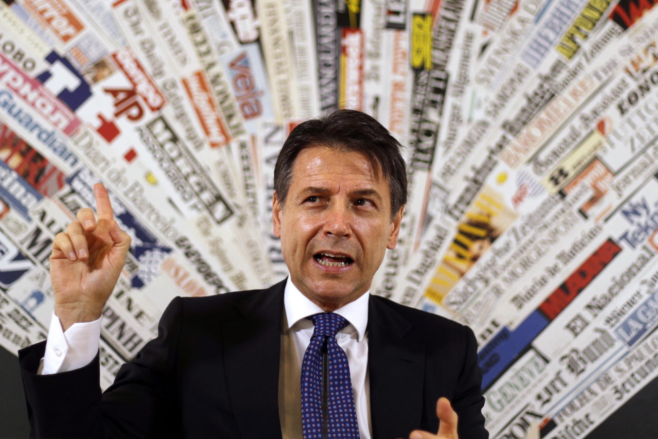 <p> Italian Premier Giuseppe Conte answers reporters' questions during a press conference at the foreign press club in Rome, Monday, Oct. 22, 2018. (AP Photo/Gregorio Borgia) </p>