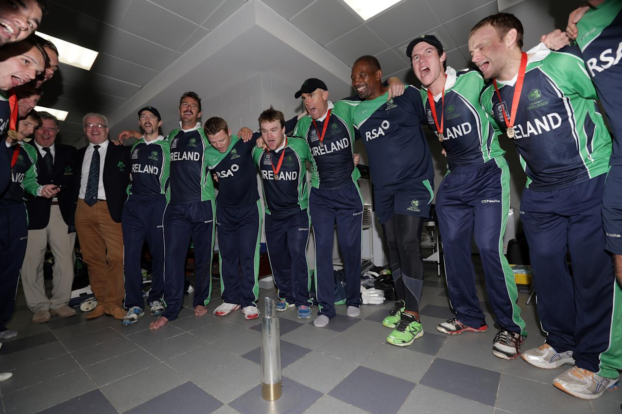 ABU DHABI - NOVEMBER 30: The Irish team celebrate with a song in the dressing rooms after their victory over Afghanistan in the Ireland v Afghanistan Final at the ICC World Twenty20 Qualifiers at the Zayed Cricket Stadium on November 30, 2013 in Abu Dhabi, United Arab Emirates.  (Photo by Graham Crouch-IDI/IDI via Getty Images)