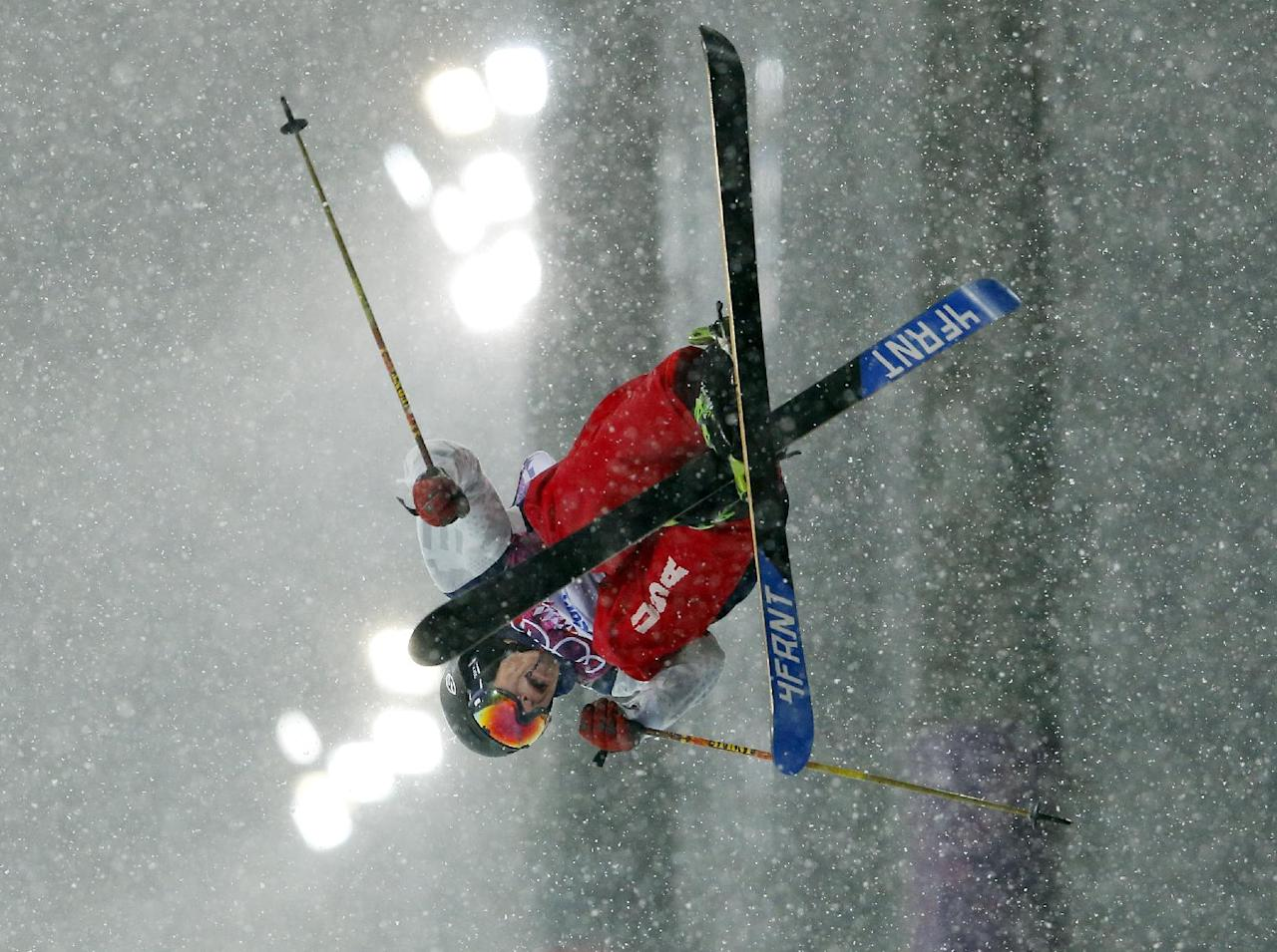 David Wise of the United States gets air during the men's ski halfpipe final at the Rosa Khutor Extreme Park, at the 2014 Winter Olympics, Tuesday, Feb. 18, 2014, in Krasnaya Polyana, Russia. (AP Photo/Sergei Grits)