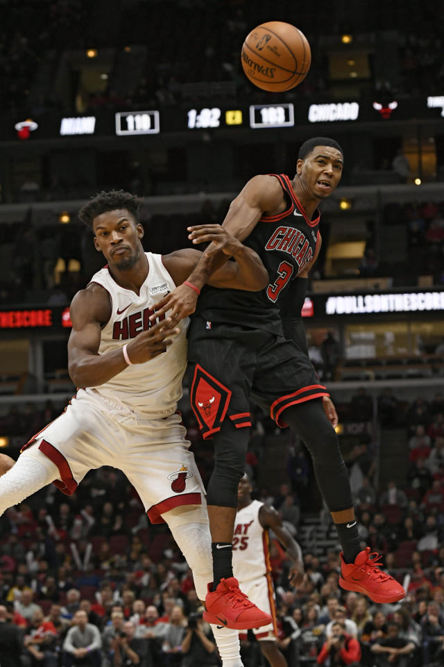 Miami Heat's Jimmy Butler (22) battles Chicago Bulls' Shaquille Harrison (3) for an inbound pass during the second half of an NBA basketball game Friday, Nov. 22, 2019, in Chicago. Miami won 116-108. (AP Photo/Paul Beaty)