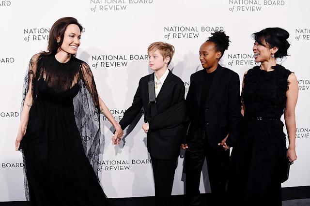 <p>It was girls' night out for the mom of six and her daughters, Shiloh Jolie-Pitt and Zahara Jolie-Pitt, who made an appearance at the 2018 National Board of Review Awards Gala in New York City on Tuesday, human-rights activist — and Jolie's good pal — Loung Ung rounded out the party of four. (Photo: Dia Dipasupil/FilmMagic) </p>