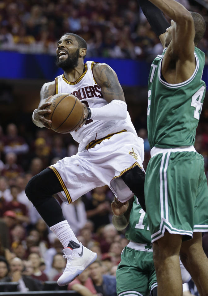<p> Cleveland Cavaliers' Kyrie Irving (2) goes up for a shot against Boston Celtics' Al Horford (42), from Dominican Republic, during the second half of Game 4 of the NBA basketball Eastern Conference finals, Tuesday, May 23, 2017, in Cleveland. (AP Photo/Tony Dejak) </p>