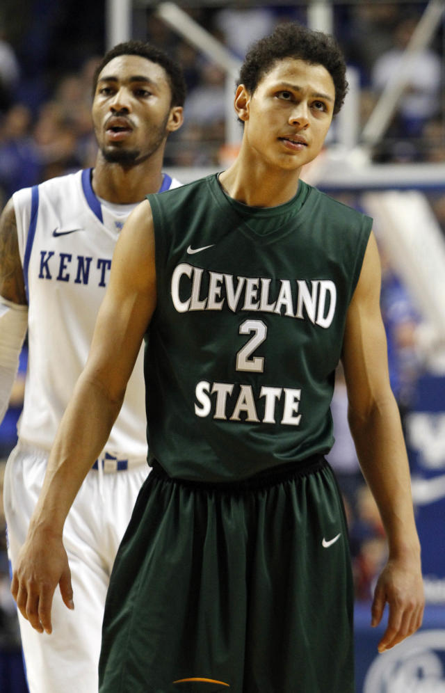 Cleveland State's Bryn Forbes (2) looks dejectedly at the score board late in the second half of an NCAA college basketball game against Kentucky, Monday, Nov. 25, 2013, in Lexington, Ky. Kentucky won 68-61. (AP Photo/James Crisp)