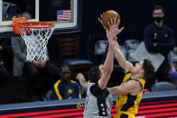 Indiana Pacers' Doug McDermott (20) has his shot blocked by Washington Wizards' Alex Len (27) during the first half of an NBA basketball game, Saturday, May 8, 2021, in Indianapolis. (AP Photo/Darron Cummings)