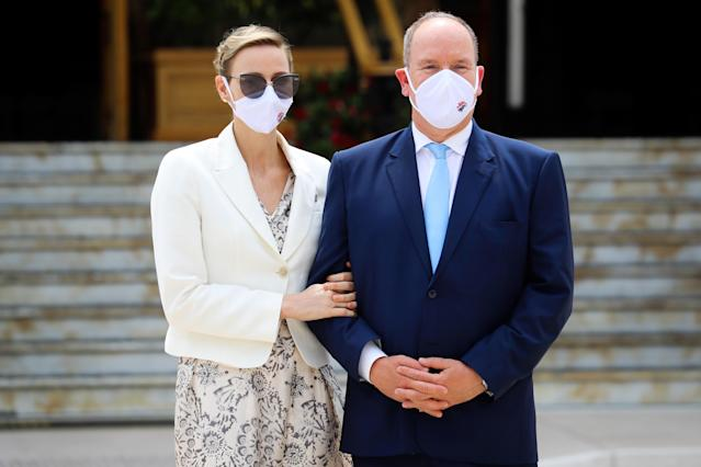 Prince's Albert II of Monaco and Princess Charlene of Monaco wearing a protective facemask, attend the inauguration of the new Casino place, in Monaco, on June 2, 2020 as the Principality eases lockdown measures taken to curb the spread of the COVID-19 (the novel coronavirus). (Photo by VALERY HACHE / AFP) (Photo by VALERY HACHE/AFP via Getty Images)
