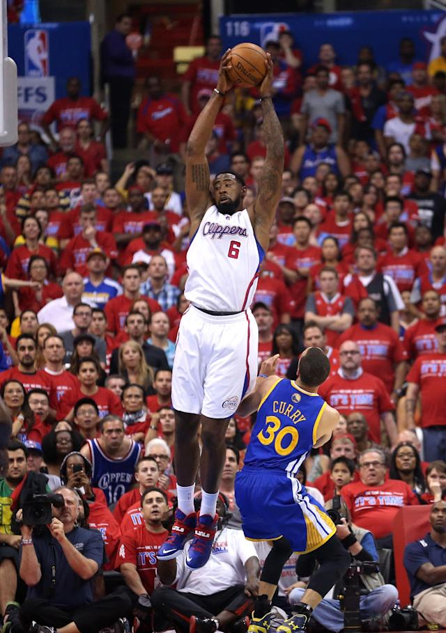 LOS ANGELES, CA - MAY 03: DeAndre Jordan #6 of the Los Angeles Clippers catches a pass over Stephen Curry #30 of the Golden State Warriors in Game Seven of the Western Conference Quarterfinals during the 2014 NBA Playoffs at Staples Center on May 3, 2014 in Los Angeles, California. NOTE TO USER: User expressly acknowledges and agrees that, by downloading and or using this photograph, User is consenting to the terms and conditions of the Getty Images License Agreement. (Photo by Stephen Dunn/Getty Images)