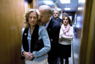 Democratic presidential hopeful, Sen. Joe Biden, D-Del., rests his head on the shoulder of his wife, Jill, as they stand in a hallway awaiting his introduction for a rally at the UAW Hall in Dubuque, Iowa, on the day of the Iowa caucus Thursday, Jan. 3, 2008. (AP Photo/Mark Hirsch)