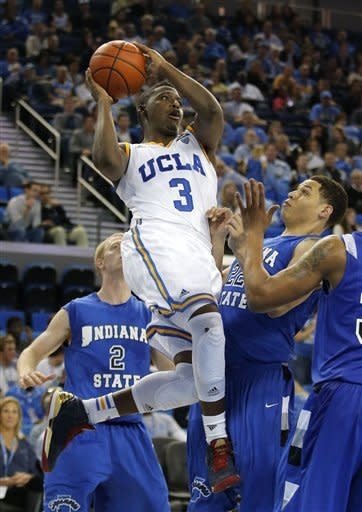 UCLA's Jordan Adams, center, looks to pass as Indiana State's Brandon Burnett, right, watches during the second half of an NCAA college basketball game in Los Angeles, Friday, Nov. 9, 2012. UCLA won 86-59. (AP Photo/Jae C. Hong)