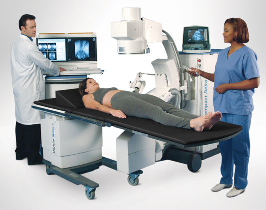 A stock photo of the lithotripter machine. Oopsie -- they forgot to sedate the patient.