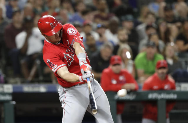 Los Angeles Angels' Mike Trout connects on a three-run home run against the Seattle Mariners in the ninth inning of a baseball game Saturday, July 20, 2019, in Seattle. (AP Photo/Elaine Thompson)