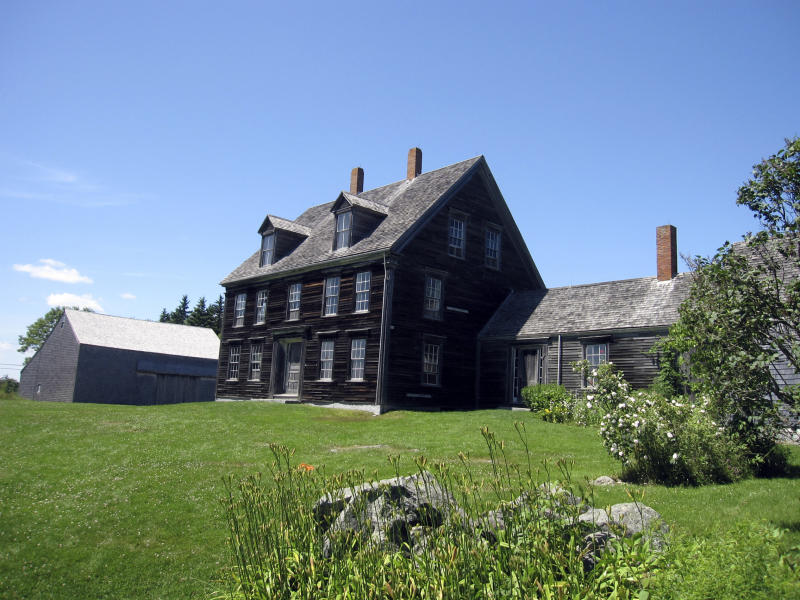 """This July 7, 2011 photo shows the Olson House, which was declared a National Historic Landmark June 30, in Cushing, Maine. The farmhouse was made famous in Andrew Wyeth's painting """"Christina's World,"""" which depicts Christina Olson dragging herself across a field toward the house, where she lived with her brother for decades until shortly before their deaths in the late 1960s.  (AP Photo/Beth Harpaz)"""