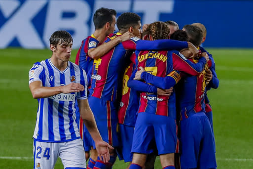 Barcelona's Frenkie de Jong celebrates with teammates after scoring his side's second goal during the Spanish La Liga soccer match between FC Barcelona and Real Sociedad at the Camp Nou stadium in Barcelona, Spain, Wednesday, Dec. 16, 2020. (AP Photo/Joan Monfort)
