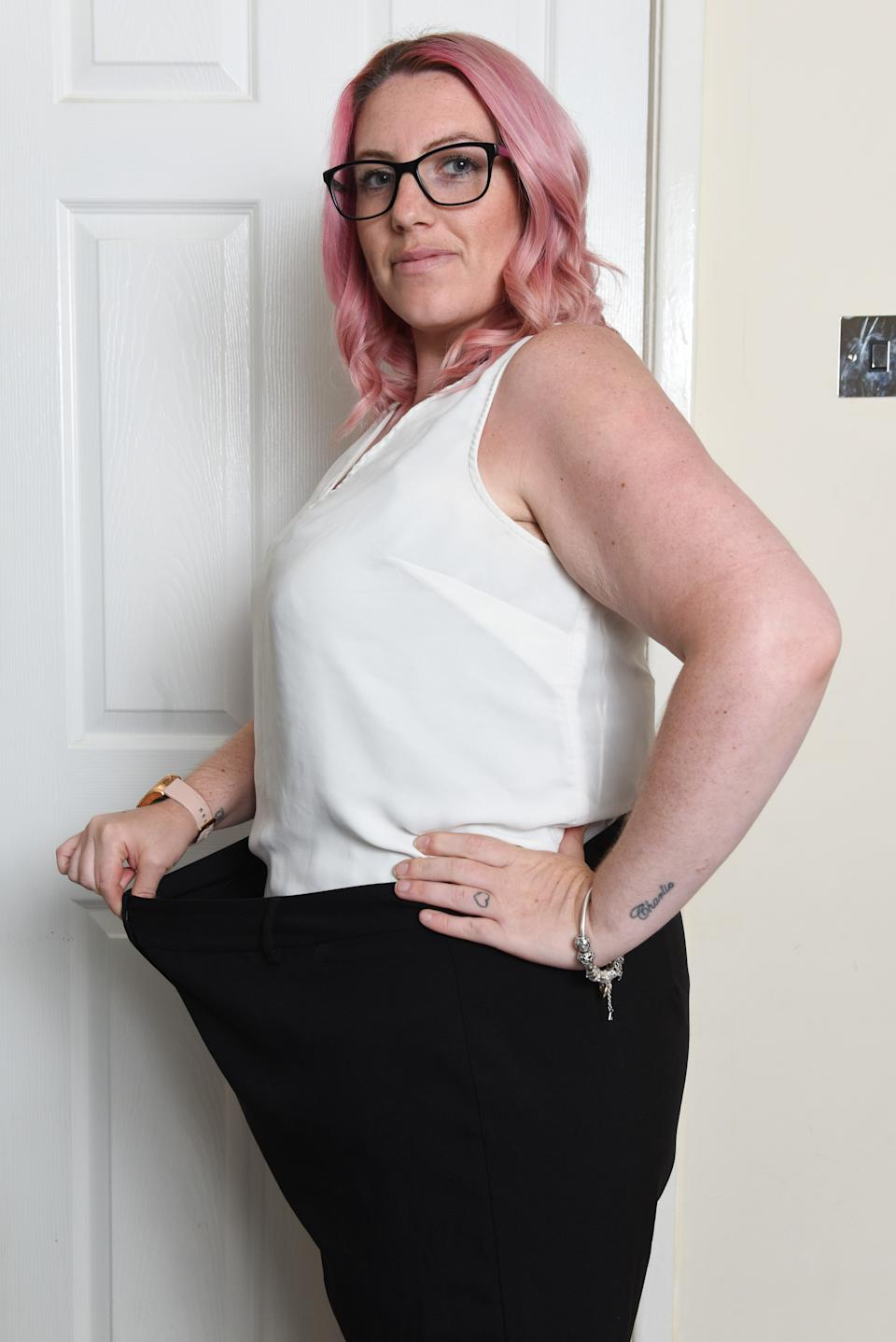 Ashleigh with an old pair of trousers) An obese bridesmaid has dropped six stone after a 'horrific' photo appeared online which made her look nine month pregnant. Ashleigh Bell, 32, says the photo changed her life and she suddenly realised that her size 24 waistline couldn't balloon any further. The mum-of-three spotted the photo on Facebook last July six months after her sister's wedding in 2018. Ashleigh says she felt 'mortified' by the awful image - which she says made her look pregnant - and actually apologised to her sister for being obese on her special day. SEE CATERS COPY
