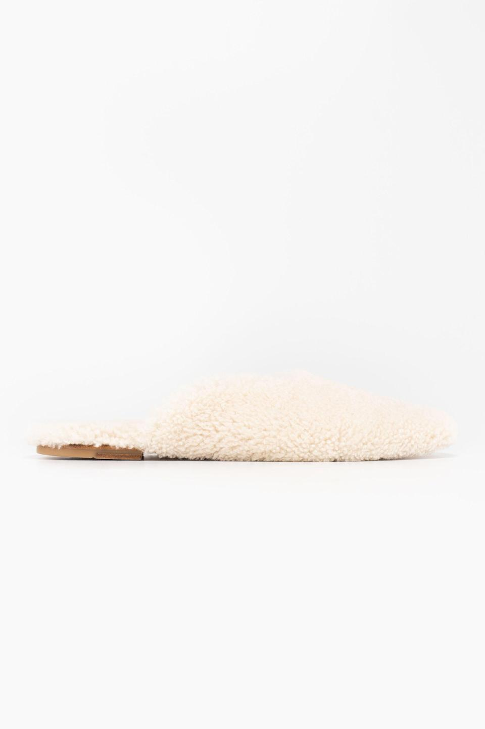 """<p><strong>The Sleeper </strong></p><p>the-sleeper.com</p><p><strong>$290.00</strong></p><p><a href=""""https://the-sleeper.com/en/product/cream-shearling-slippers/"""" rel=""""nofollow noopener"""" target=""""_blank"""" data-ylk=""""slk:SHOP IT"""" class=""""link rapid-noclick-resp"""">SHOP IT </a></p><p>This shearling pair is equal parts cozy and chic. </p>"""
