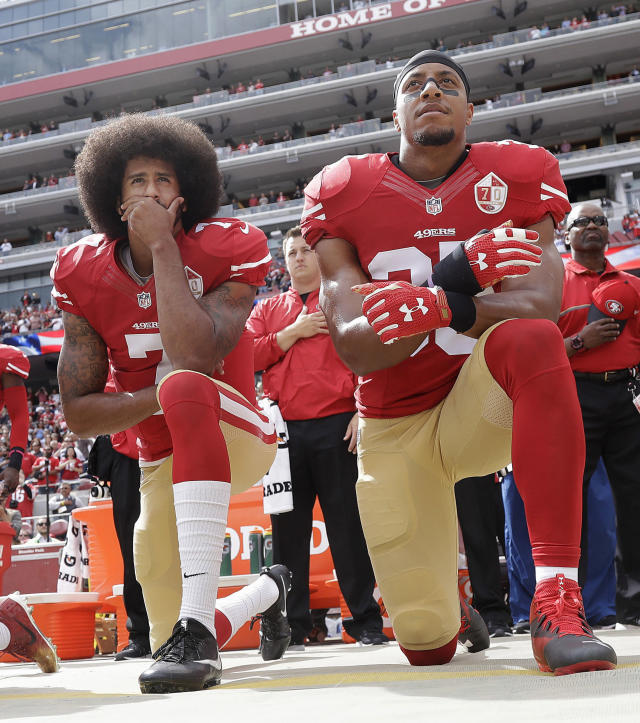 "FILE - In this Oct. 2, 2016, file photo, San Francisco 49ers quarterback Colin Kaepernick, left, and safety Eric Reid kneel during the national anthem before an NFL football game against the Dallas Cowboys in Santa Clara, Calif. The NFL players' union has filed a non-injury grievance on behalf of free agent safety Eric Reid. The NFLPA cites one team appearing ""to have based its decision not to sign a player based on the player's statement that he would challenge the implementation of a club's policy prohibiting demonstration during the national anthem. (AP Photo/Marcio Jose Sanchez, File)"