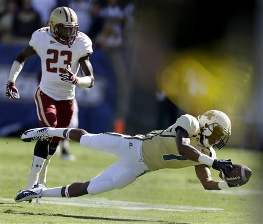 Georgia Tech running back B.J. Bostic, right, catches a pass in front of Boston College defensive back Jim Noel, left, during the first quarter of an NCAA college football game, Saturday, Oct. 20, 2012, in Atlanta. (AP Photo/David Goldman)