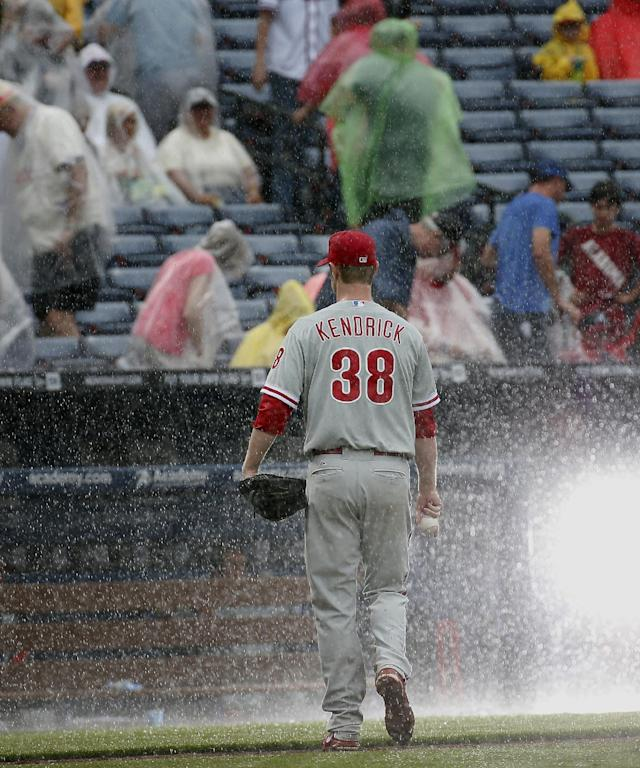 Philadelphia Phillies starting pitcher Kyle Kendrick (38) leaves the field as play is stopped for rain during the sixth inning of a baseball game against the Atlanta Braves in Atlanta, Sunday, July 20, 2014. (AP Photo/John Bazemore)
