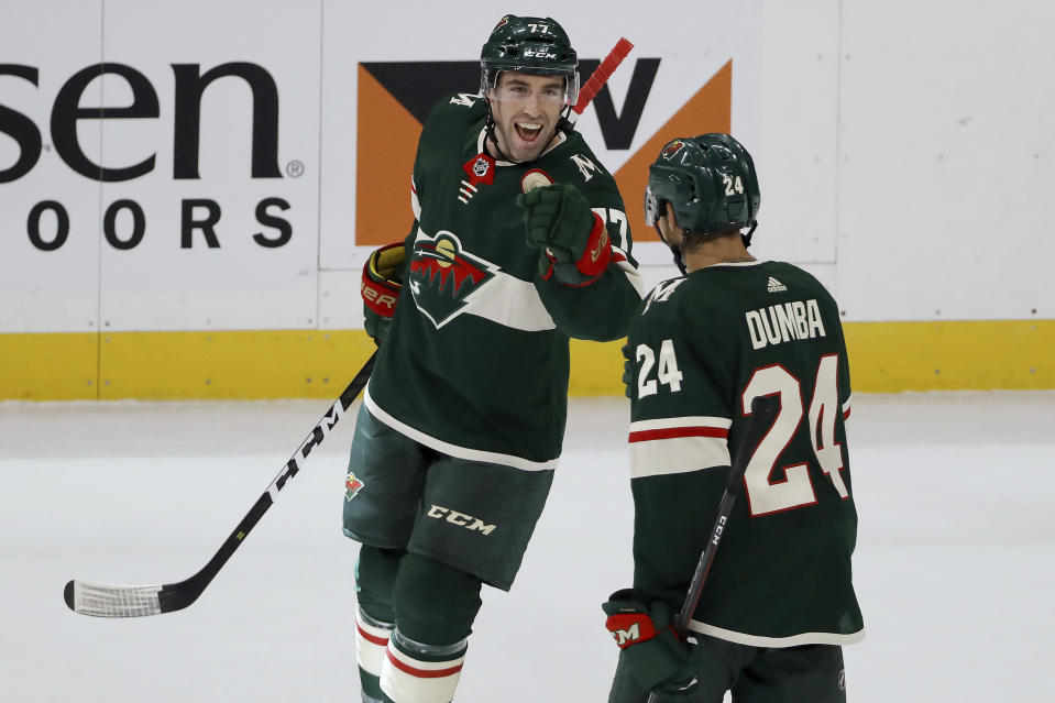 Minnesota Wild's Brad Hunt (77) celebrates with Matt Dumba (24) after Hunt scored a goal against the Edmonton Oilers during the first period of an NHL hockey game Tuesday, Oct. 22, 2019, in St. Paul, Minn. (AP Photo/Stacy Bengs)